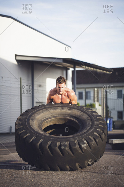 Man training with tire