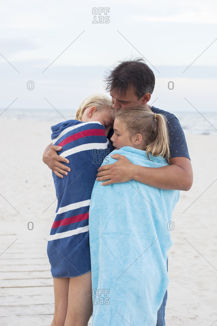 Father with daughters on beach