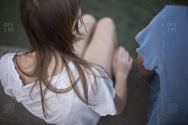 Girl sitting, high angle view