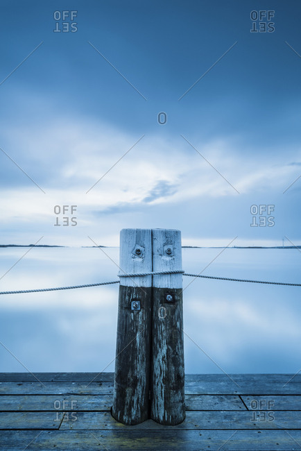 Wooden pole on jetty