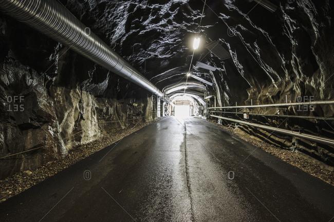 Tunnel through rock