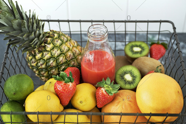 Fruits and juice in wire basket