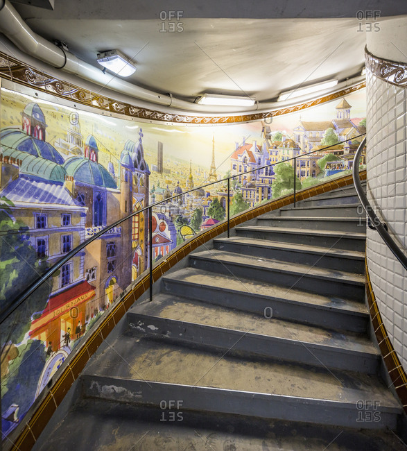 Paris, France - June 26, 2017: Representation of the city of Paris on the wall near the stair of Metro station at Abbesses