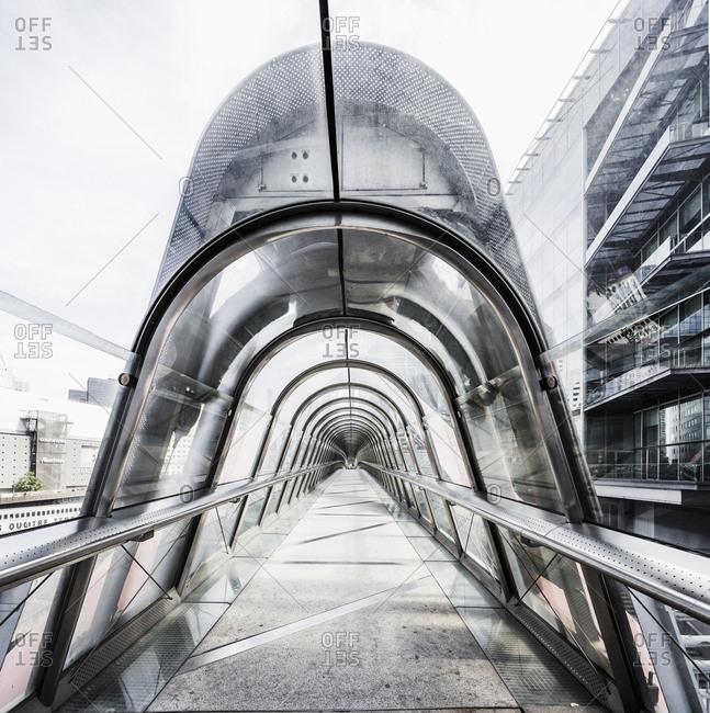 Paris, France - June 23, 2017: La Defense, the Japan Bridge (also known as passerelle Kupka), a footbridge designed by the architect Kisho Kurokawa