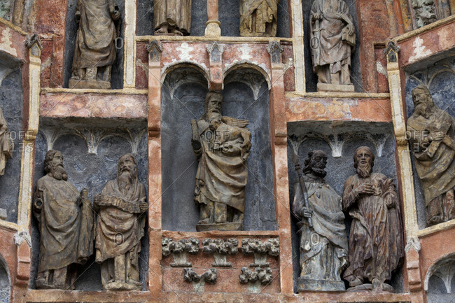 Zagreb, Croatia - May 22, 2015: Religious sculptures stand in specific alcoves on a church facade