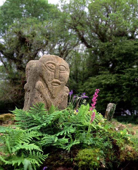 Lower Lough, Erne, County Fermanagh, Northern Ireland - April 17, 2002: A Janus Stone sits among ferns