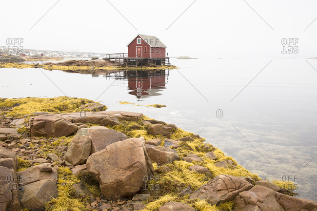 A wooden fishing stage on the shoreline of Fogo Island
