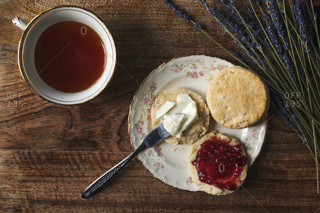 Tea served with a freshly baked scone with butter and jam