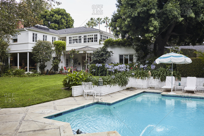 Los Angeles, California, USA - June 24, 2017: Georgian Colonial style home with swimming pool by architect Paul R. Williams