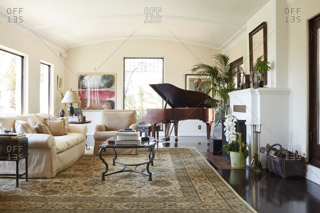 Los Angeles, California, USA - June 18, 2017: Living room with piano in Spanish Colonial Revival style home