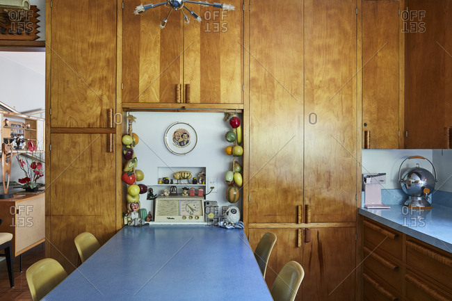 Ontario, California, USA - June 23, 2017: Kitchen table and cabinets in mid-century modern home