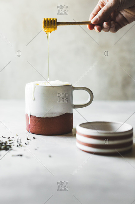 Honey tea latte with handmade ceramic mug and dish