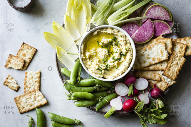 Spring vegetables and hummus on a platter