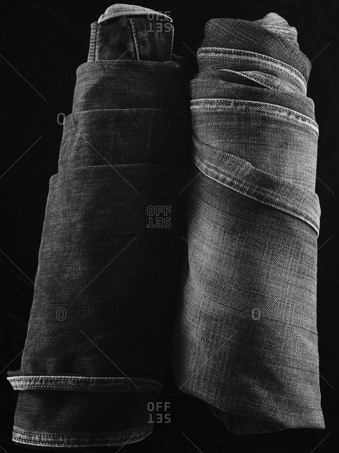 Close-up of two pairs of folded denim jeans