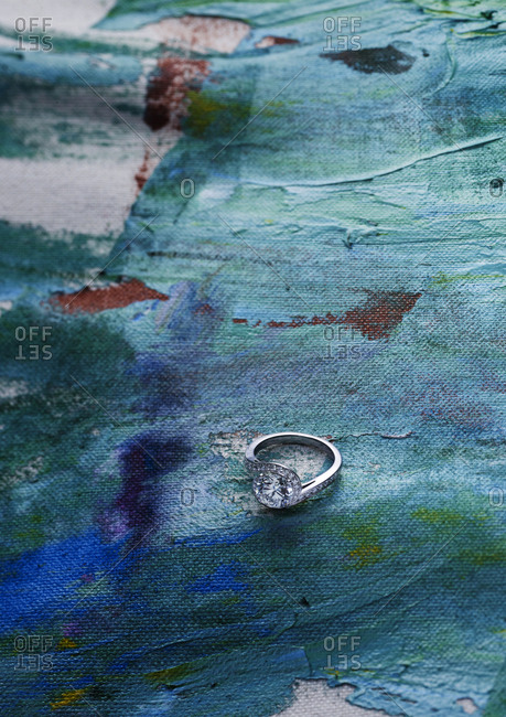 Diamond ring on blue painted canvas