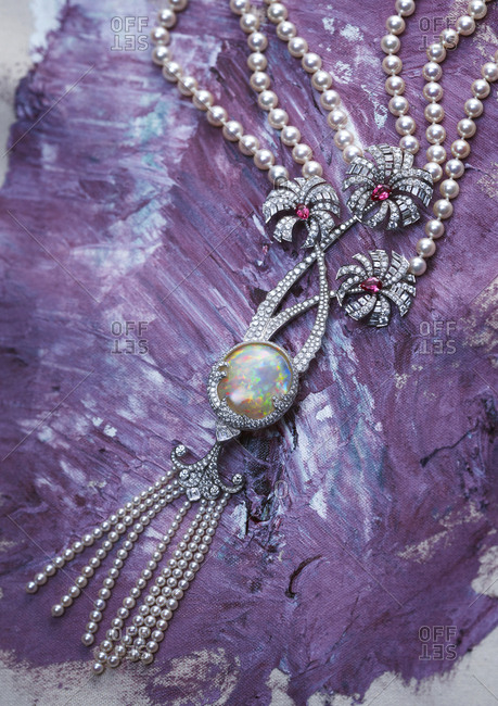 Exquisite opal, diamond, and pearl necklace on painted canvas
