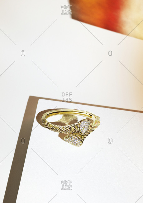 Designer diamond ring on white background