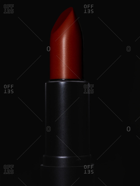 Close-up of red lipstick in black tube