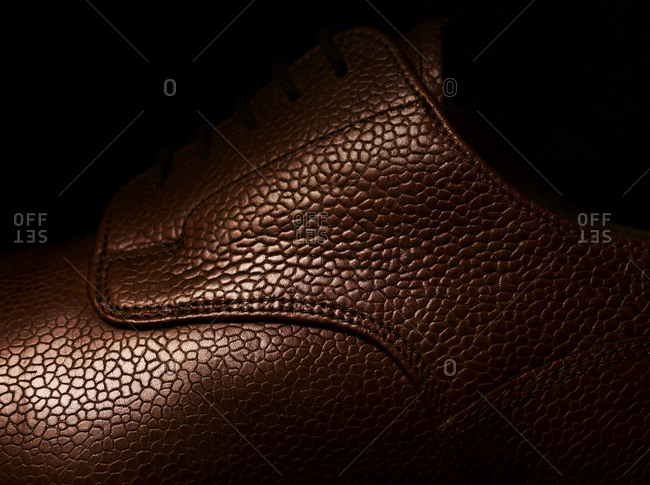 Close-up of pebble textured leather of a man's luxury shoe