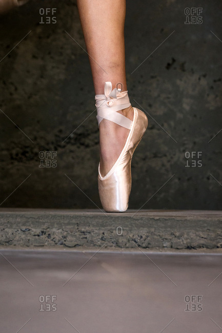 Single foot of a ballet dancer in pointe shoe