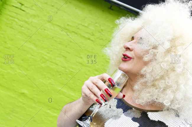 New York City - June 25, 2017: Drag queen having a cocktail