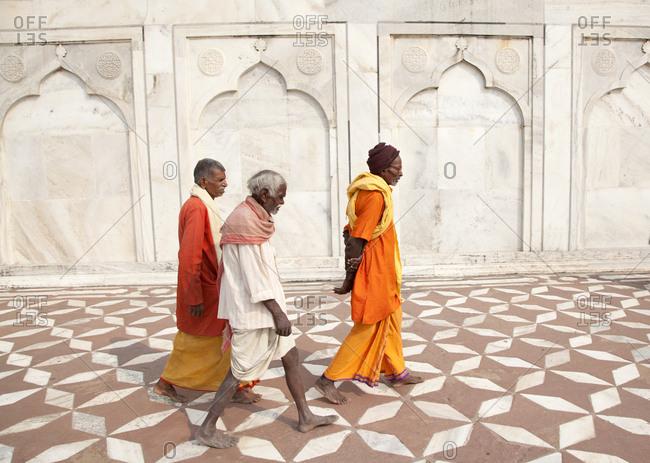 Agra, India - October 21, 2011: Old men visiting Taj Mahal