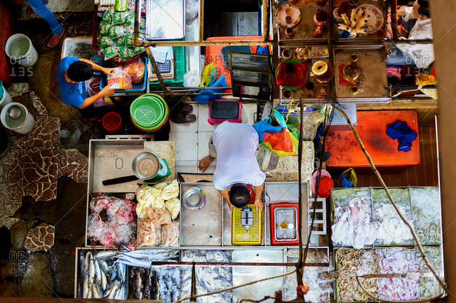 Phnom Penh, Cambodia - June 24, 2017: Man organizing his seafood stall - O'Russey Market