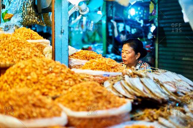 Phnom Penh, Cambodia - June 24, 2017: Woman selling dried shrimp - O'Russey Market