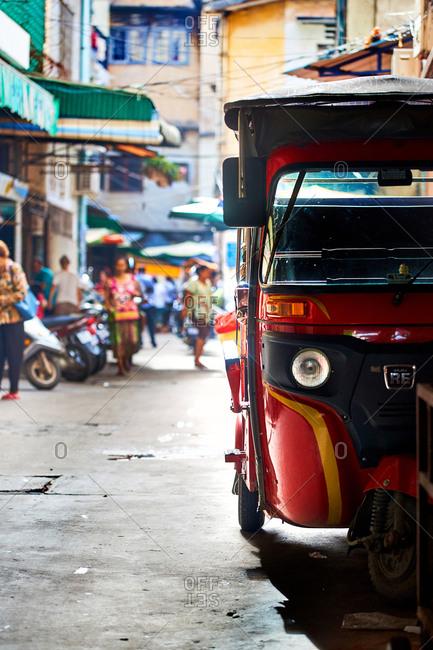 Phnom Penh, Cambodia - June 24, 2017: Tuk tuk in an alleyway