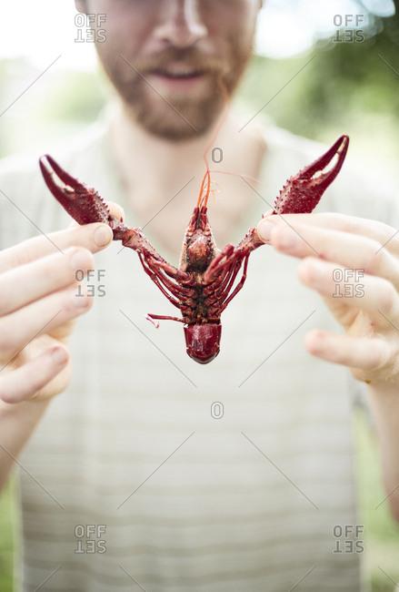 Man holding a crawfish
