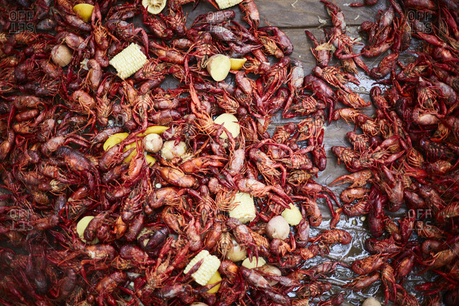 A table with crawfish and corn