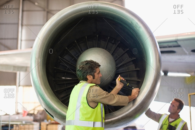 Aircraft workers checking airplane