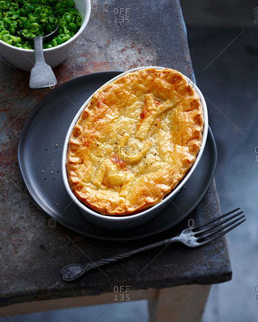 Dish of baked pie and peas