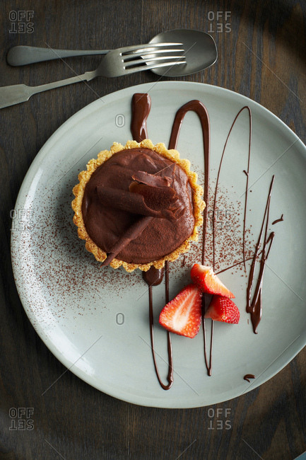 Chocolate tart on plate