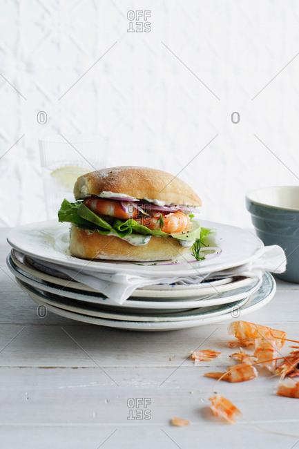 Plate of shrimp and lettuce sandwich