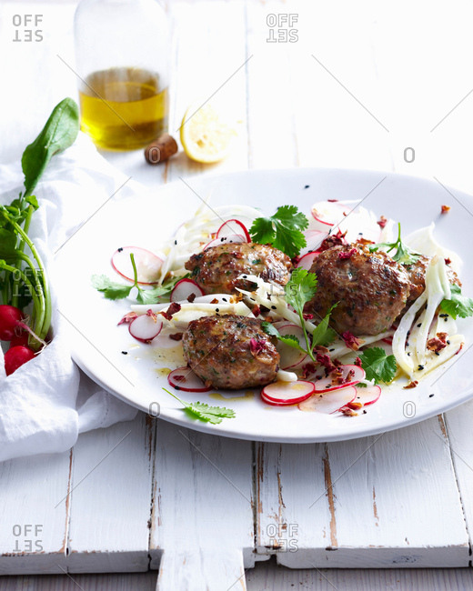 Plate of meatballs with radishes