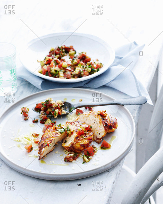Plate of chicken with salsa