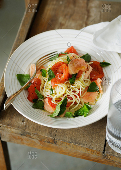 Plate of fish and tomato pasta