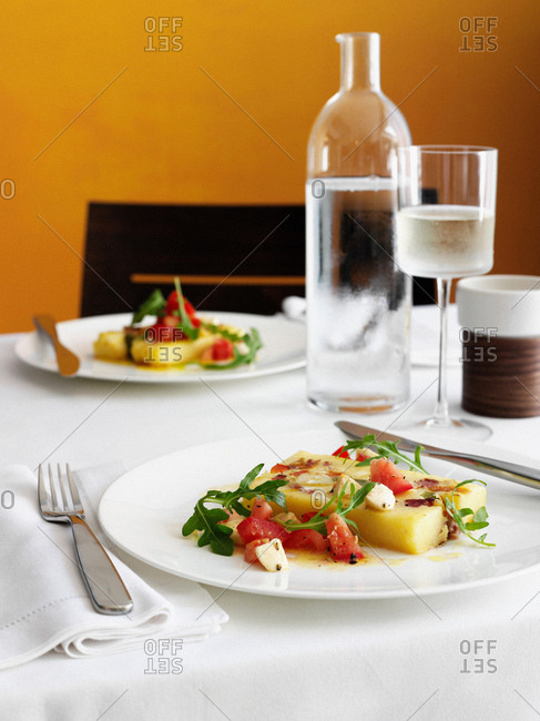 Plates of melon salad on table