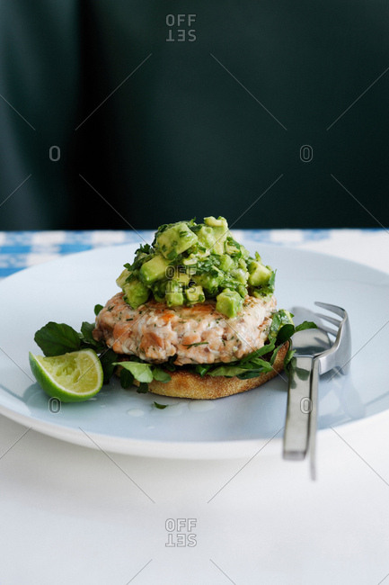 Plate of fish patty with avocado