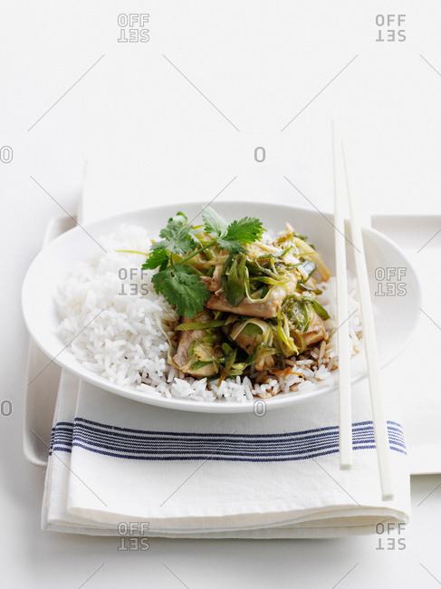 Bowl of fish with herbs and rice
