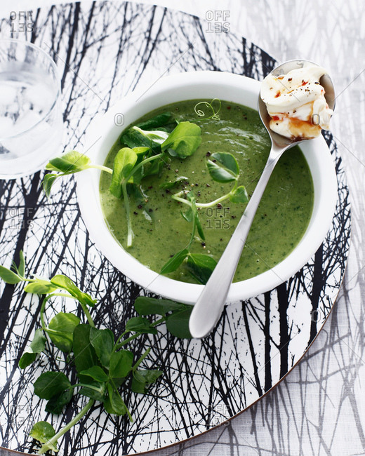 Bowl of pea soup with cream cheese
