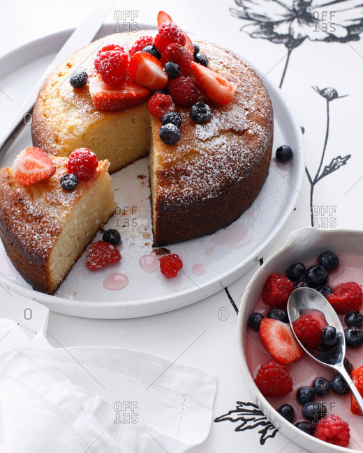 Platter of rose cake with berry topping