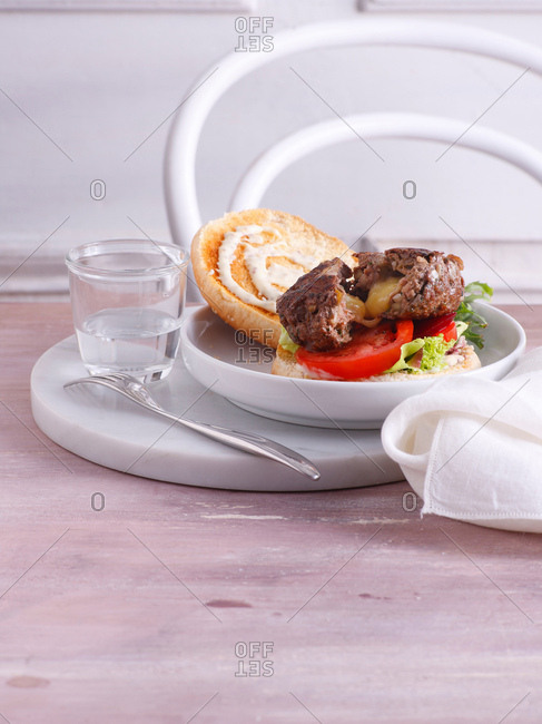 Plate of burger with glass of water
