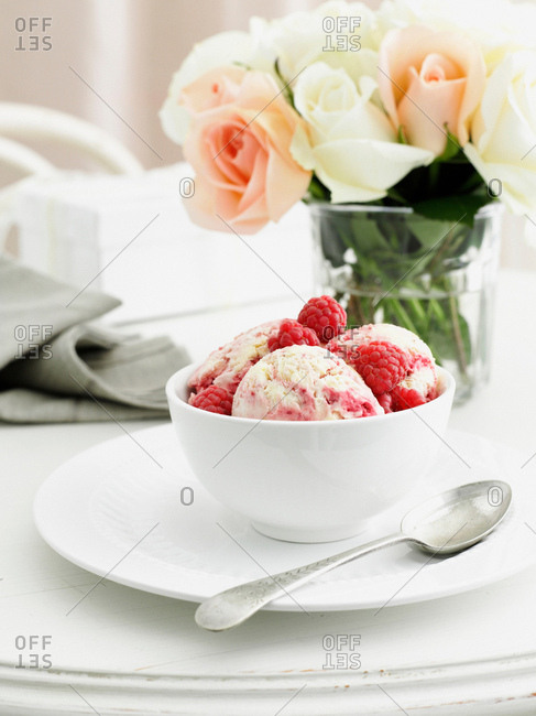 Bowl of berry ice cream on table