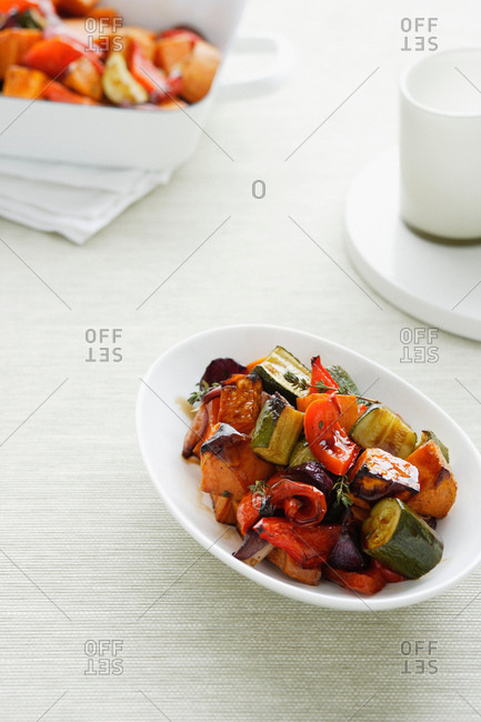 Bowl of roasted vegetables on table