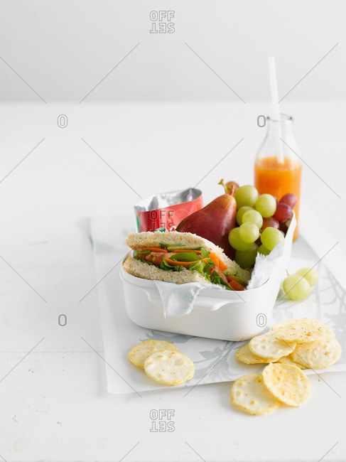 Healthy food in lunch box with crackers
