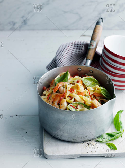 Pot of vegetable pasta on board