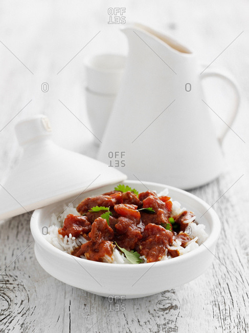 Bowl of meat over rice