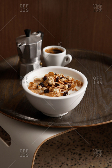 Bowl of granola with cup of coffee